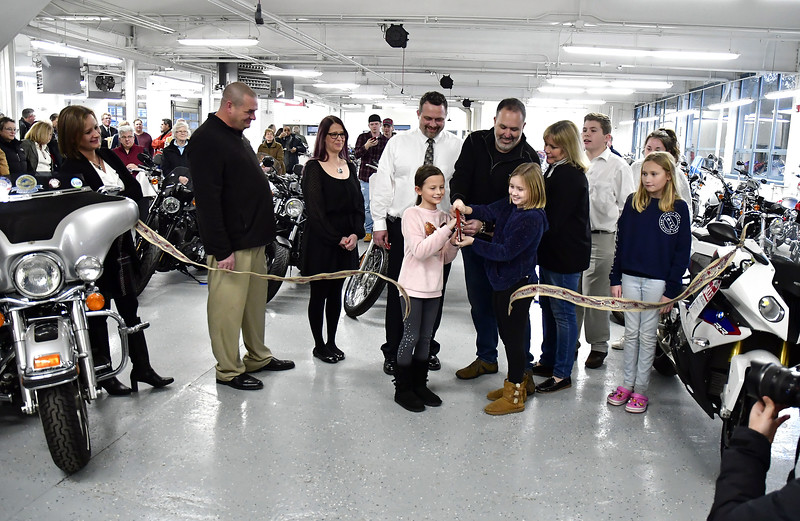1/16/2020 Mike Orazzi | Staff The Powerhouse Motorsports ribbon cutting on Thursday evening in Plainville.