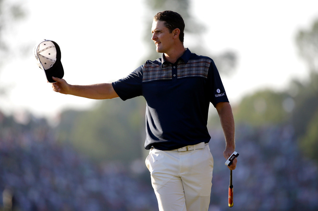 . Justin Rose, of England, reacts after a putt on the 18th hole during the fourth round of the U.S. Open golf tournament at Merion Golf Club, Sunday, June 16, 2013, in Ardmore, Pa. (AP Photo/Morry Gash)