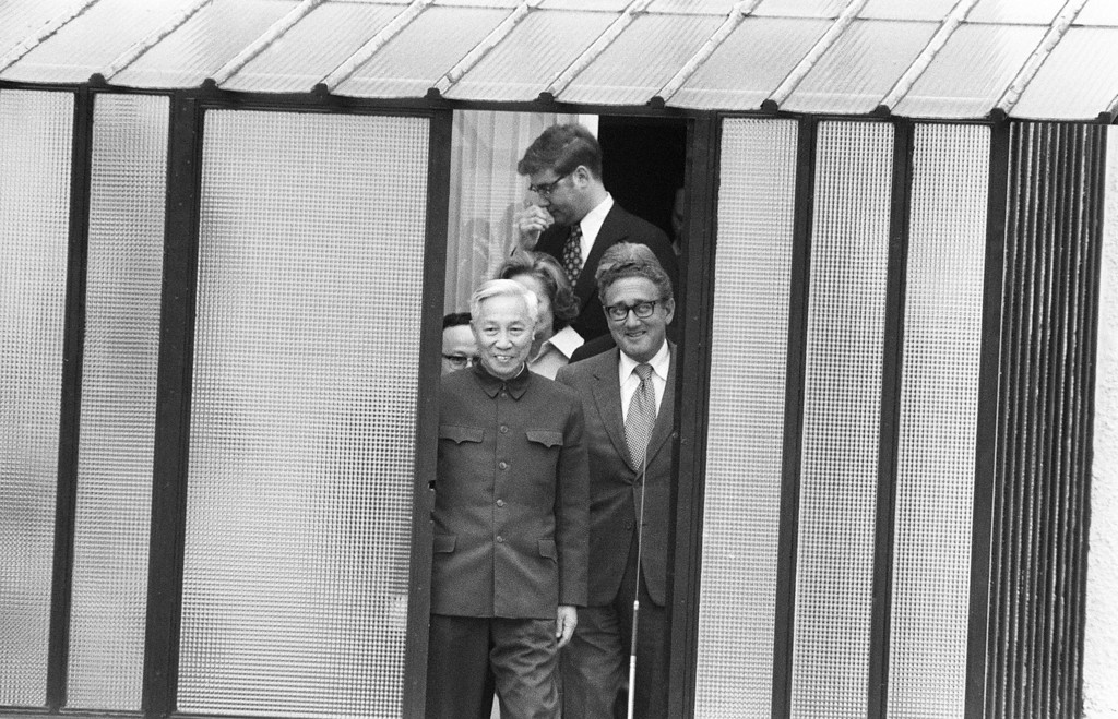 . PARIS, FRANCE - JANUARY 23, 1973:  US National Security Adviser Henry Kissinger (R) and Le Duc Tho, leader of North Vietnam delegation, leave the house where they met regarding the enforcement of the Paris Peace Accords, 23 January 1973 in Paris, France. (Photo by AFP/Getty Images)