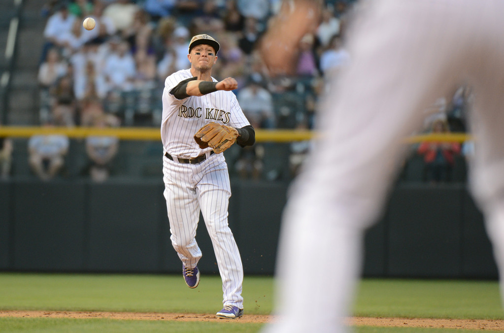 . Denver, CO. - June 08: Troy Tulowitzki of Colorado Rockies (2) is in action in the 8th inning of the game against San Diego Padres at Coors Field. Denver, Colorado. June 8, 2013. San Diego won 4-2. (Photo By Hyoung Chang/The Denver Post)