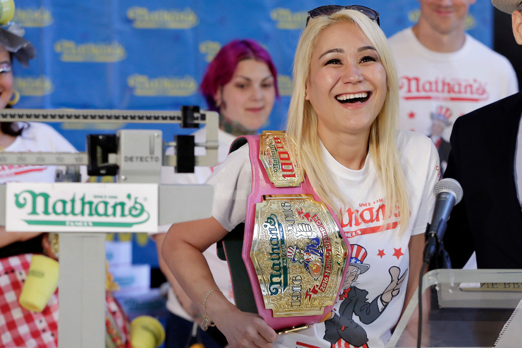 . Current women\'s champion Miki Sudo, of Las Vegas, holds her championship belt during the weigh-in for the 2017 Nathan\'s Hot Dog Eating Contest, in Brooklyn Borough Hall, in New York, Monday, July 3, 2017. Ms. Suto weighed-in at 126 pounds. (AP Photo/Richard Drew)