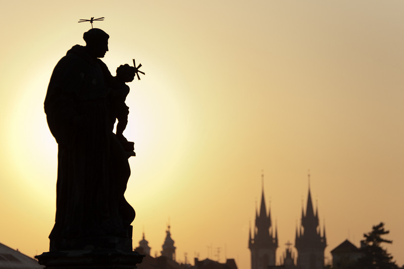 Statue silhouette with Prague Castle in the background - Prague, Czech Republic