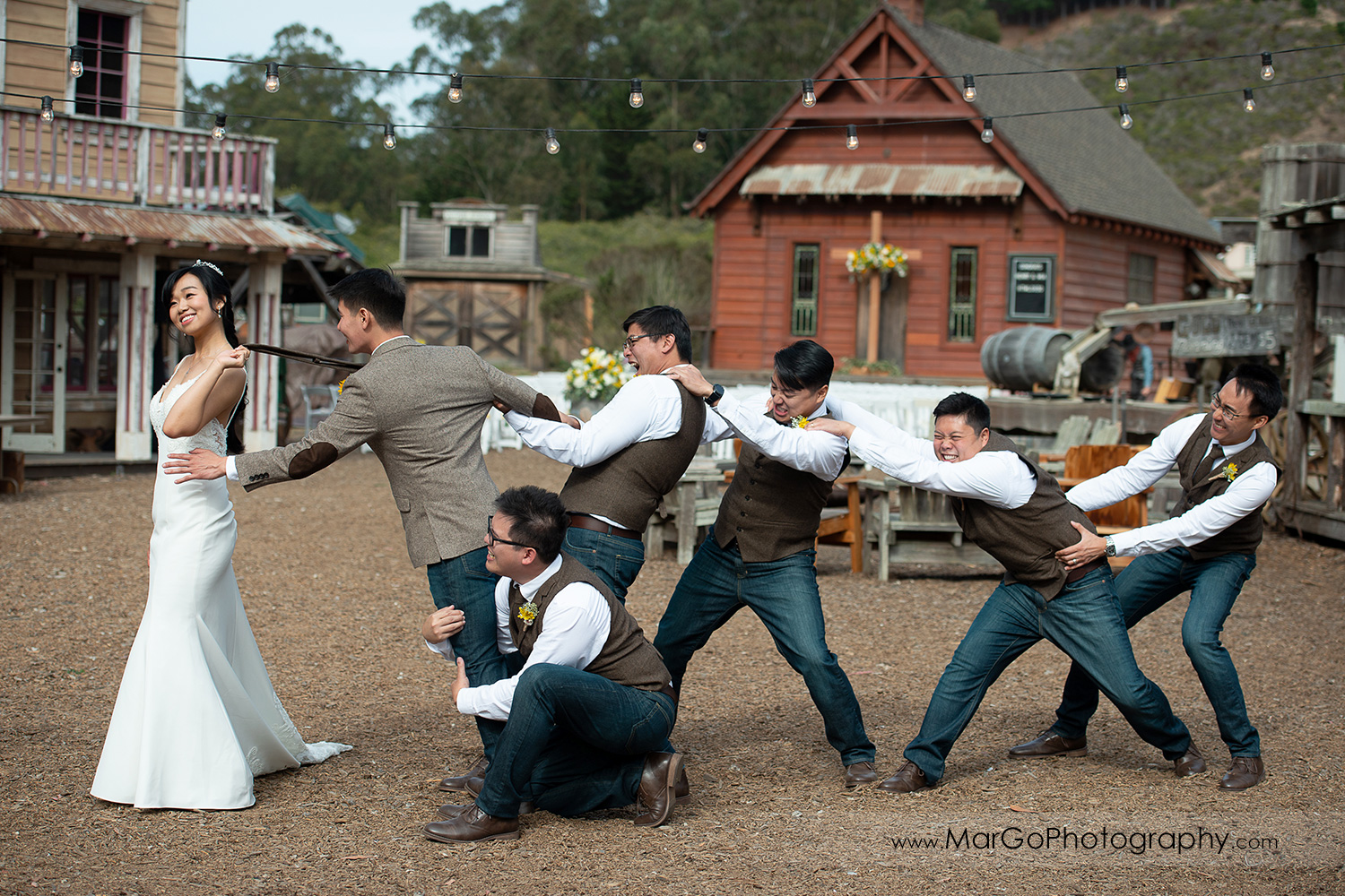 groomsmen fighting with bride over groom at Long Branch Saloon & Farms in Half Moon Bay