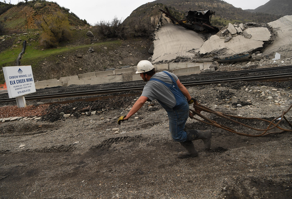 . Landon Long works on clean up after the coal silo demolition at the Oxbow Mine in Somerset, Colorado, April 29, 2016. (Photo by RJ Sangosti/The Denver Post)