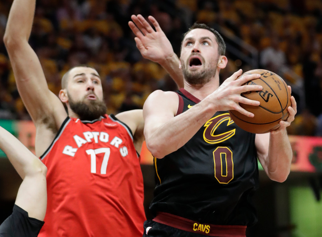 . Cleveland Cavaliers\' Kevin Love (0) shoots against Toronto Raptors\' Jonas Valanciunas in the first half of Game 4 of an NBA basketball second-round playoff series, Monday, May 7, 2018, in Cleveland. (AP Photo/Tony Dejak)