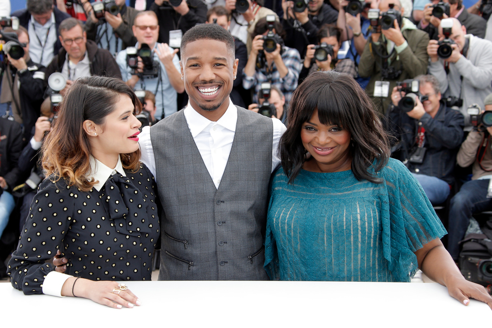 . From left, actors Melonie Diaz, Michael B. Jordan and Melonie Diaz pose for photographers during a photo call for the film Fruitvale Station at the 66th international film festival, in Cannes, southern France, Thursday, May 16, 2013. (AP Photo/Francois Mori)