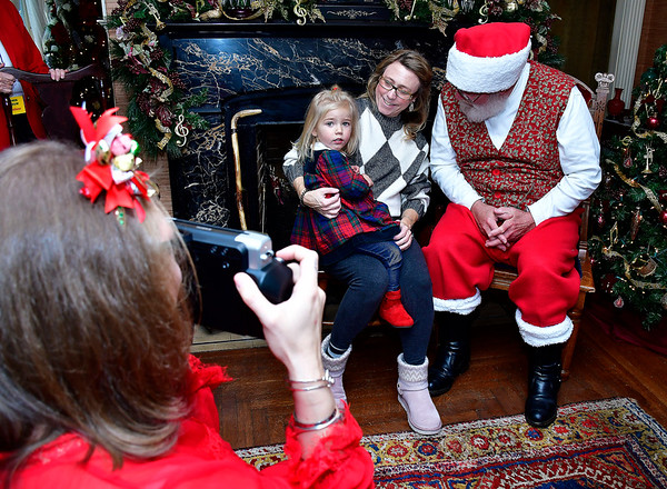 11/30/2019 Mike Orazzi | Staff Amy Rae and her daughter Gigi,2, meet with Santa at The Barnes Museum in Southington on Saturday morning.