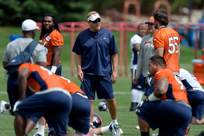 . Jack Del Rio, defensive coordinator of the Denver Broncos talks with Stewart Bradley (55) during mini camp June 12, 2013 at Dove Valley. (Photo By John Leyba/The Denver Post)
