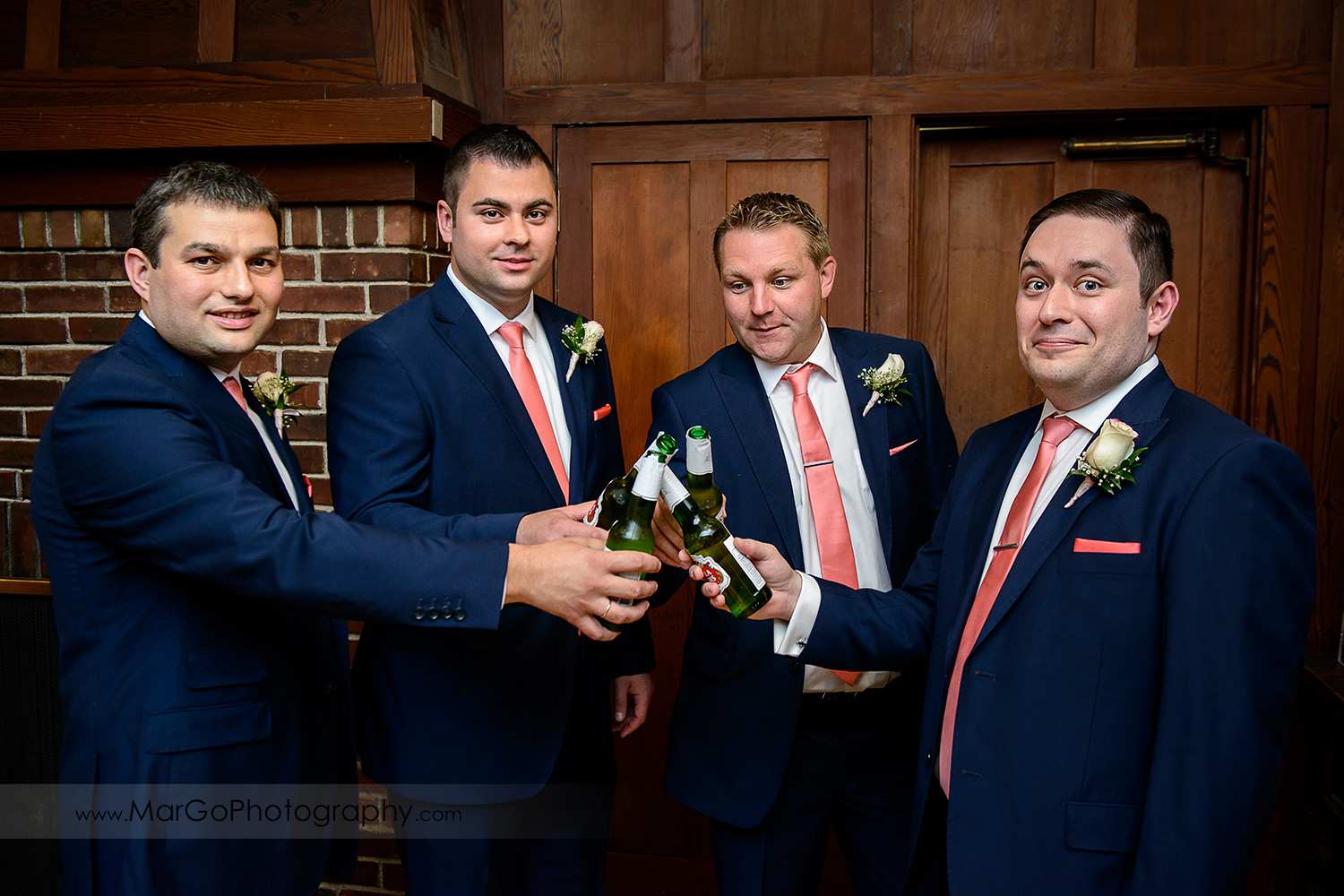 groom and groomsmen in blue suit and pink tie drinking beer at Saratoga Foothill Club