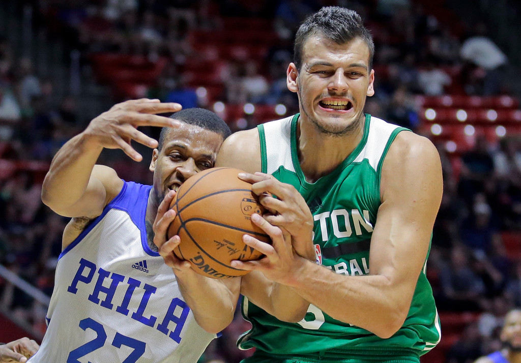 . Philadelphia 76ers guard Isaiah Briscoe (27) and Boston Celtics center Ante Zizic (54) battle for a rebound during the first half of an NBA summer league basketball game Monday, July 3, 2017, in Salt Lake City. (AP Photo/Rick Bowmer)