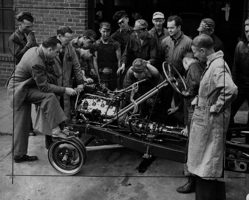 . Emily Griffith Opportunity School The Mystery of What Goes On underneath the hood of an automobile was solved  by students in auto-mechanics classes in 1941 at the Emily Griffith Opportunity School, thru the gift of a cut-away chassis by the Ford Motor company. The gift was made by E.R. Pearson, assistant sales manager of the Denver Office, in behalf of the Ford company. He is shown here with students at the school examining the exhibition chassis. Denver Post Library photo archive