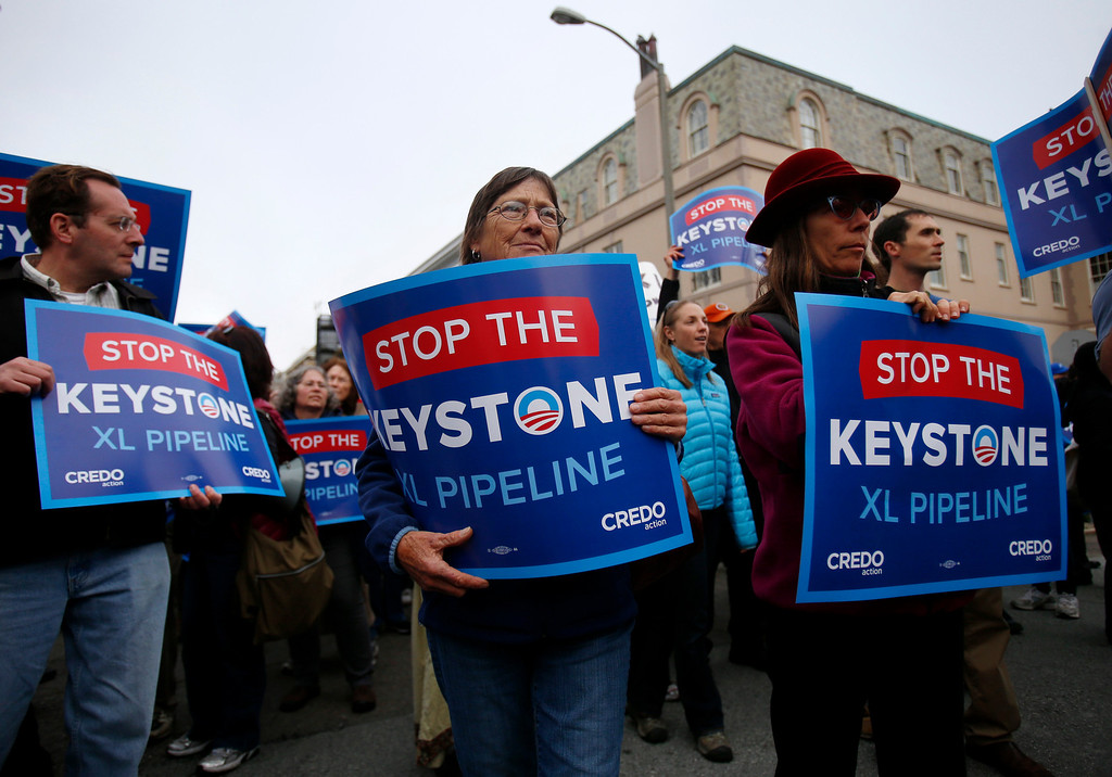 . Protesters at the intersection of Pacific Avenue and Baker Street show their opposition the plan to build a pipeline from Canada to Texas, called the Keystone XL pipeline, in Pacific Heights in San Francisco, Calif., on Wednesday, April 3, 2013.  (Nhat V. Meyer/Staff)