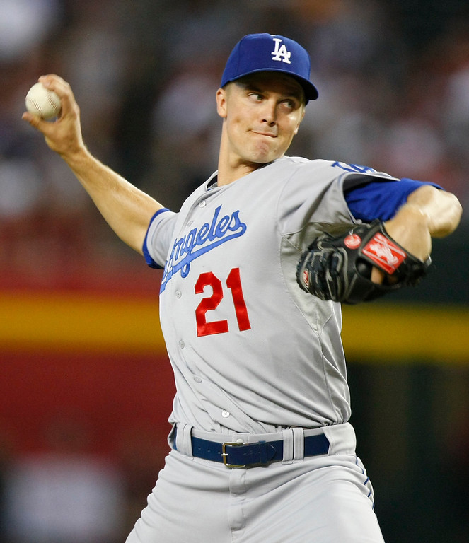 . Los Angeles Dodgers starting pitcher Zack Greinke (21) throws against the Arizona Diamondbacks in the first inning during a baseball game on Monday, July 8, 2013, in Phoenix. (AP Photo/Rick Scuteri)