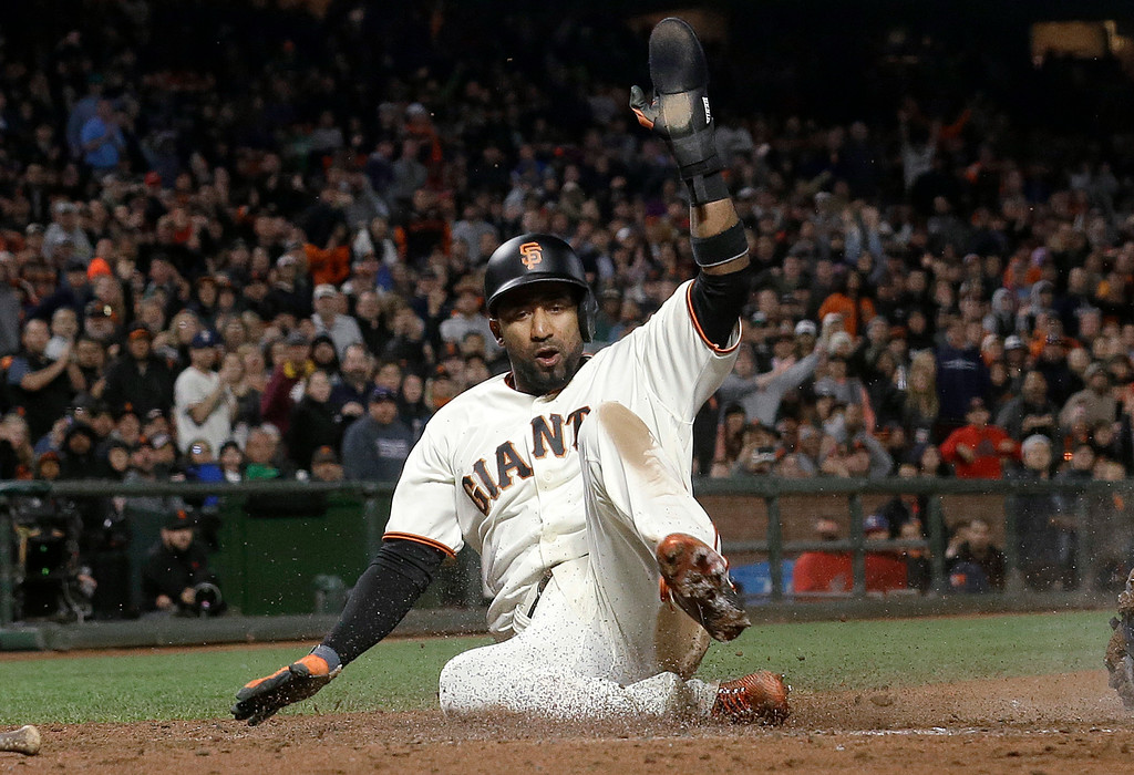 . San Francisco Giants\' Eduardo Nunez scores against the Cleveland Indians during the sixth inning of a baseball game in San Francisco, Tuesday, July 18, 2017. (AP Photo/Jeff Chiu)