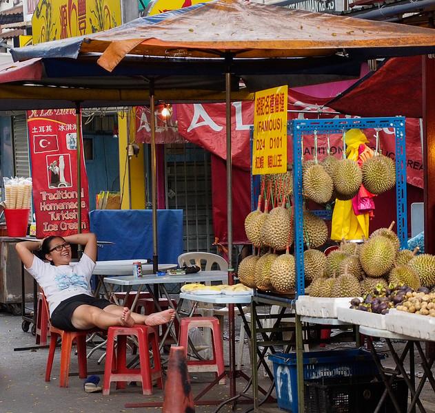 Durian seller relaxing.