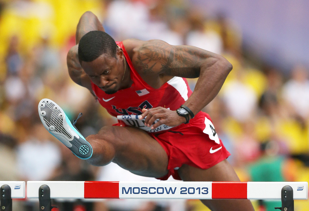 . US\'s David Oliver competes in the men\'s 110 meters hurdles semi-final at the 2013 IAAF World Championships at the Luzhniki stadium in Moscow on August 12, 2013.  AFP PHOTO / ADRIAN DENNIS/AFP/Getty Images