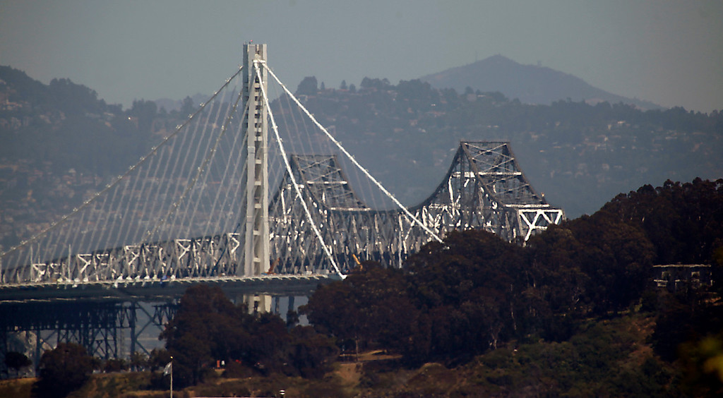 . Almost a quarter century after the Loma Prieta earthquake revealed the deadly vulnerability of the old eastern span of the Bay Bridge, a replacement span is still under construction Friday, May 24, 2013 in the middle of San Francisco Bay. (Karl Mondon/Bay Area News Group)