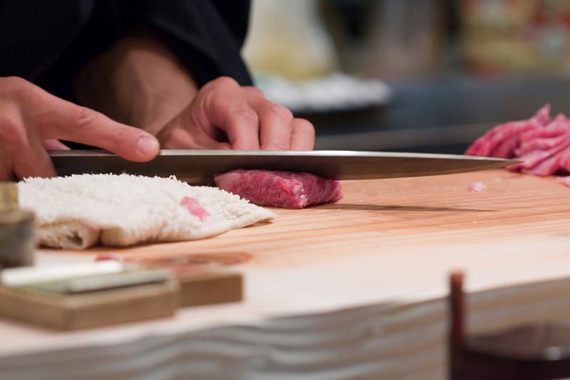 He slices the kobe beef like sashimi.