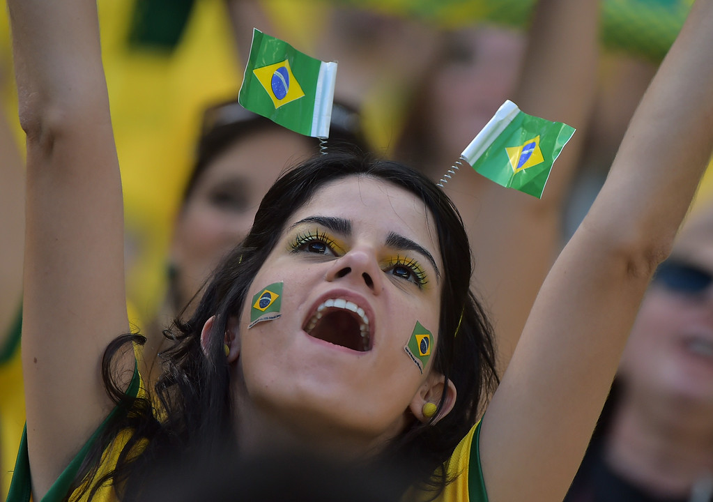. A Brazilian fan cheers before a quarter-final football match between Brazil and Colombia at the Castelao Stadium in Fortaleza during the 2014 FIFA World Cup on July 4, 2014.  GABRIEL BOUYS/AFP/Getty Images