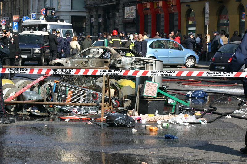 Bombed car during the demonstration left and right sides in Corso Buenos Aires, Milano, 11 marzo 2006