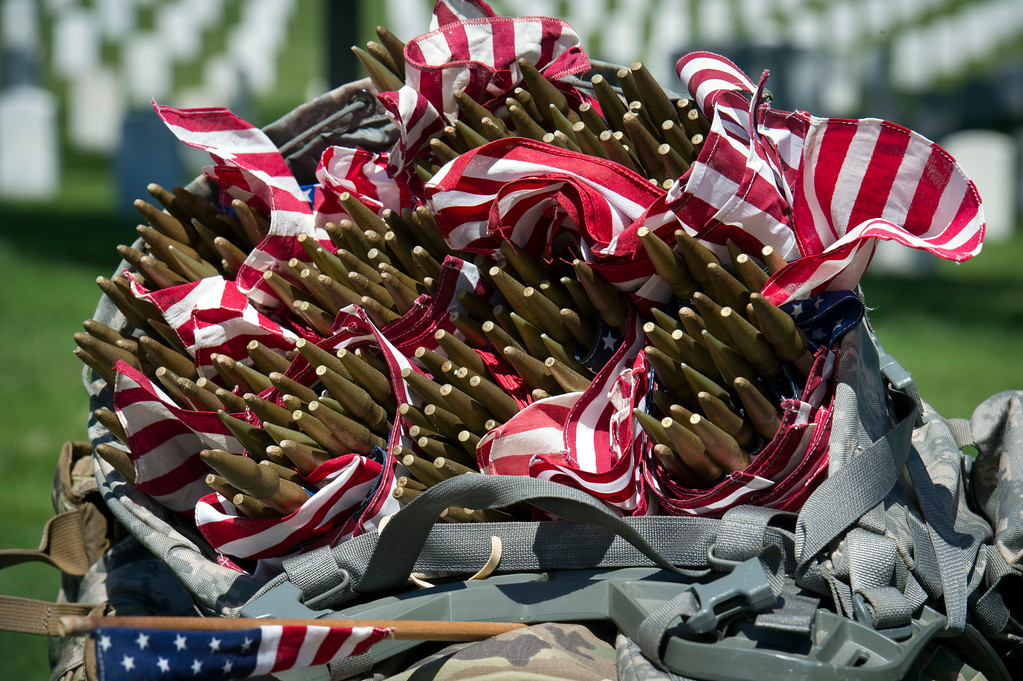 . Flags fill the backpack of a members of the Army 3d U.S. Infantry Regiment, The Old Guard, as they place flags at headstone, in honor the nation\'s fallen military heroes during its annual Flags In ceremony at Arlington National Cemetery,  Thursday, May 24, 2018, in Arlington, Va. (AP Photo/Cliff Owen)