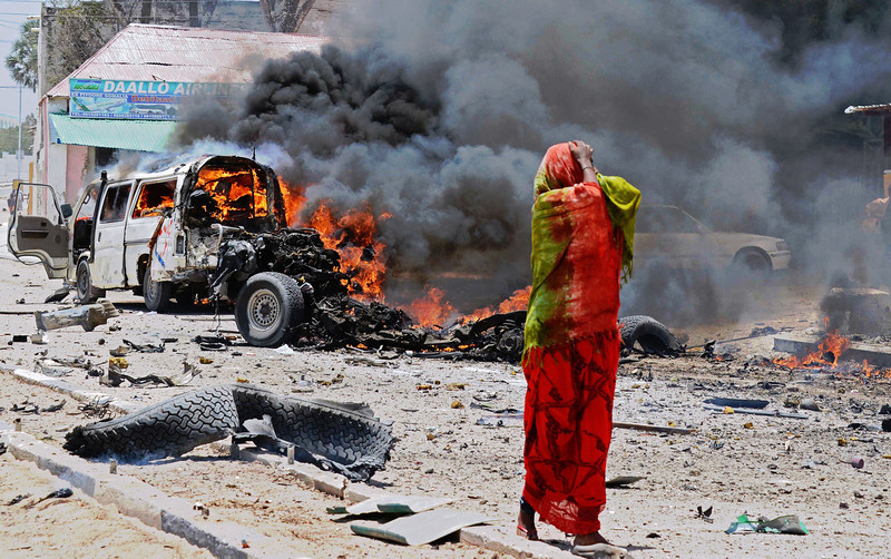 . A Somali woman reacts on March 18, 2013 near the site of a car bomb in central Mogadishu. At least eight people were killed on March 18 by a car bomb in central Mogadishu in one of the bloodiest attacks in the war-ravaged capital in recent months, police said.  Mohamed Abdiwahab/AFP/Getty Images