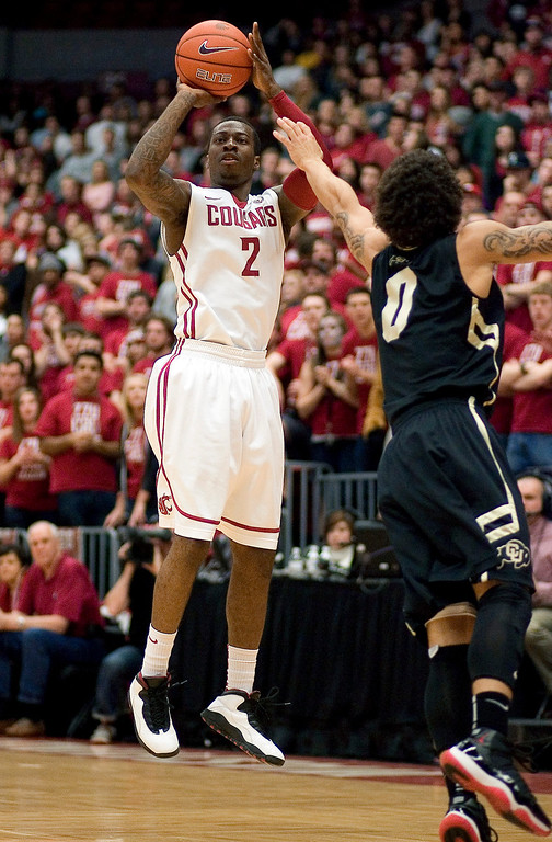 . Washington State guard Mike Ladd (2) shoots over Colorado guard Askia Booker (0) during the first half of an NCAA college basketball game Saturday, Jan. 19, 2013, in Pullman, Wash. (AP Photo/Dean Hare)