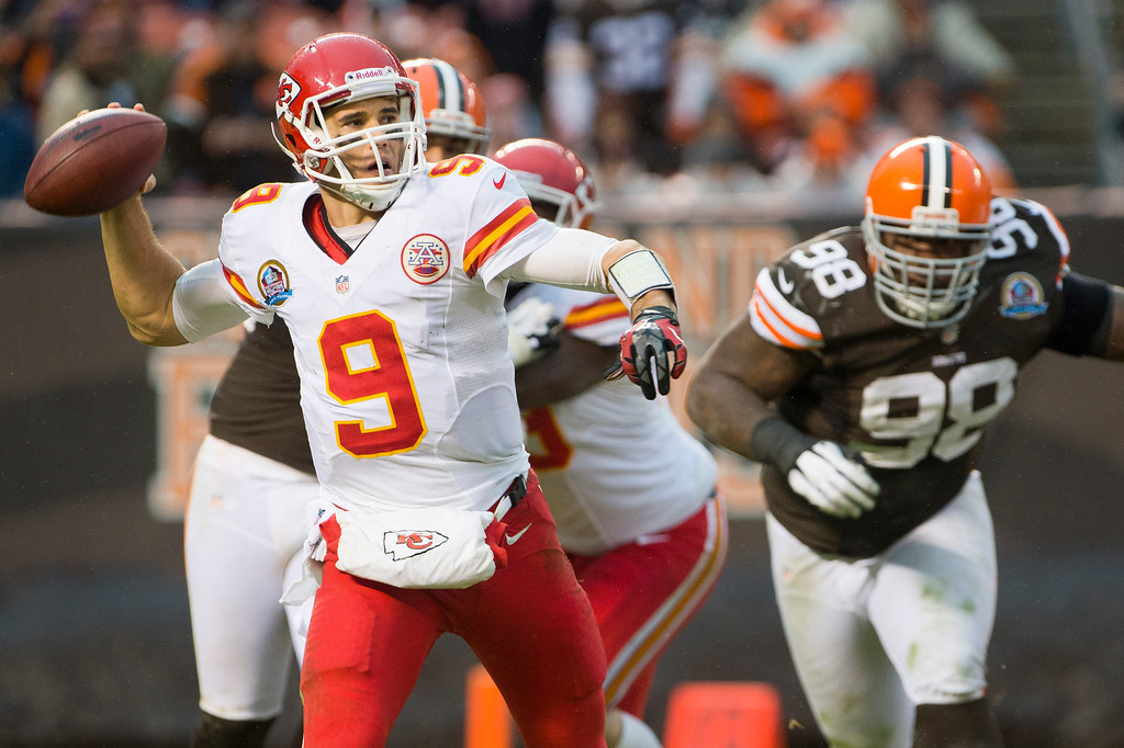 . CLEVELAND, OH - DECEMBER 09: Quarterback Brady Quinn #9 of the Kansas City Chiefs looks for a pass under pressure from defensive tackle Phillip Taylor #98 of the Cleveland Browns during the second half at Cleveland Browns Stadium on December 9, 2012 in Cleveland, Ohio. The Browns defeated the Chiefs 30-7. (Photo by Jason Miller/Getty Images)