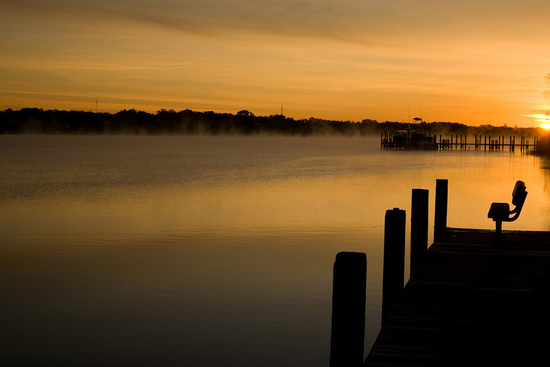 Sunrise with the fog coming off the bay in Niceville, Florida