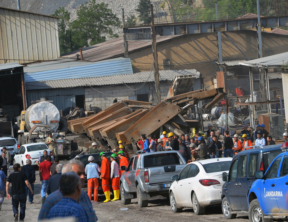 . Rescue workers at the entrance of the mine after an explosion and fire at a coal mine in Soma, in western Turkey, Tuesday, May 13, 2014. (AP Photo/IHA)