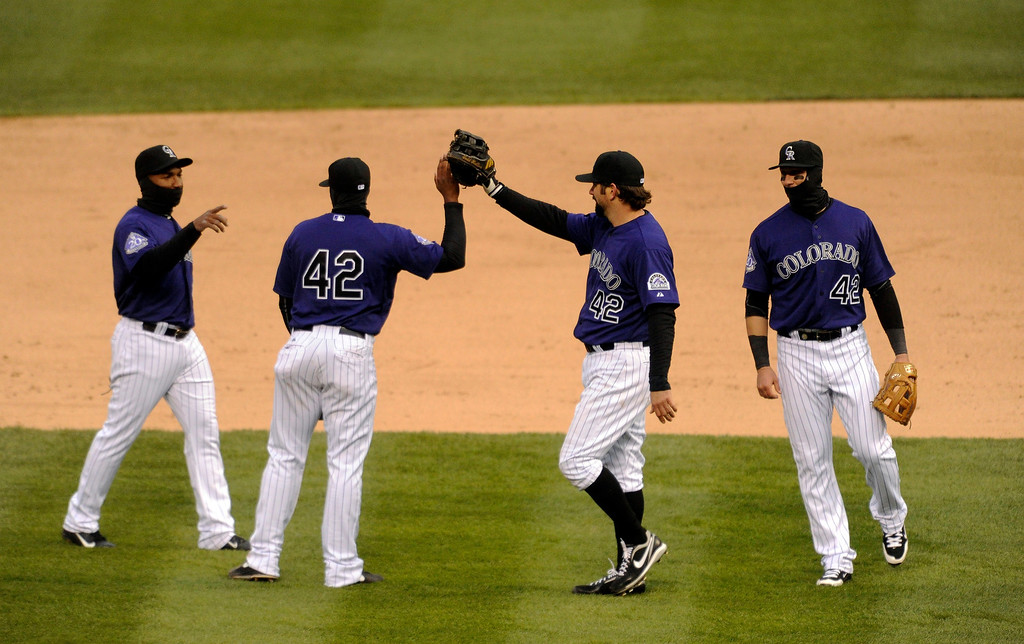 . DENVER, CO. - APRIL 16:  Colorado players celebrated the win Tuesday. The Colorado Rockies defeated the New York Mets 8-4 in a make up game Tuesday afternoon, April 16, 2013. Monday night\'s game was snowed out at Coors Field.  Photo By Karl Gehring/The Denver Post)