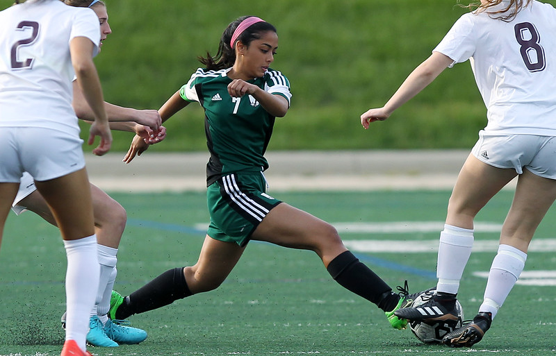 Rhea Mathias (7), West Bloomfield, stretches out to make a play during varsity soccer action at Birmingham Seaholm High School Thursday, May 17, 2018. (For The Oakland Press / LARRY McKEE)