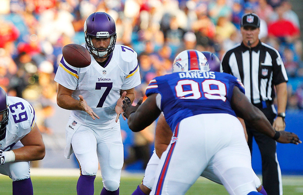 . Minnesota Vikings quarterback Christian Ponder (7) loses the snap during the first half of an NFL preseason football game against the Buffalo Bills Friday, Aug. 16, 2013, in Orchard Park, N.Y.  (AP Photo/Bill Wippert)