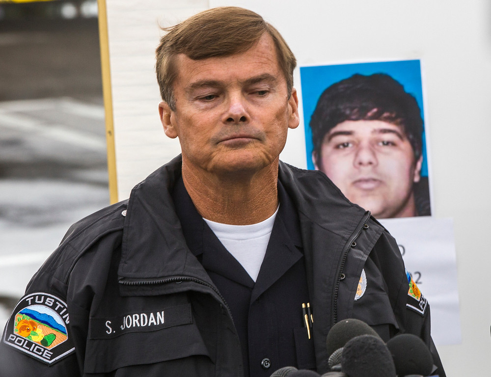 . Tustin Police Chief Scott Jordan takes questions about the gunman, Ali Syed, a suspect in a series of shootings during a news conference in Tustin, Calif., Tuesday, Feb. 19, 2013. In less than an hour, Syed, an unemployed part-time student, shot and killed a woman in her home and two commuters during carjackings early Tuesday, shot up vehicles on a Southern California freeway and committed suicide as police closed in on him, authorities said. (AP Photo/Damian Dovarganes)