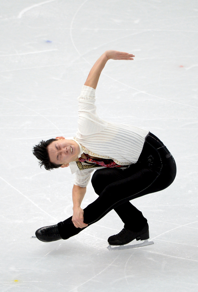 . Kazakhstan\'s Denis Ten performs in the Men\'s Figure Skating Free Program at the Iceberg Skating Palace during the Sochi Winter Olympics on February 14, 2014. (JUNG YEON-JE/AFP/Getty Images)