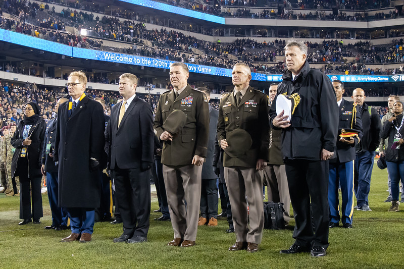 Army dignitaries stand respectfully during the singing of the alma mater.