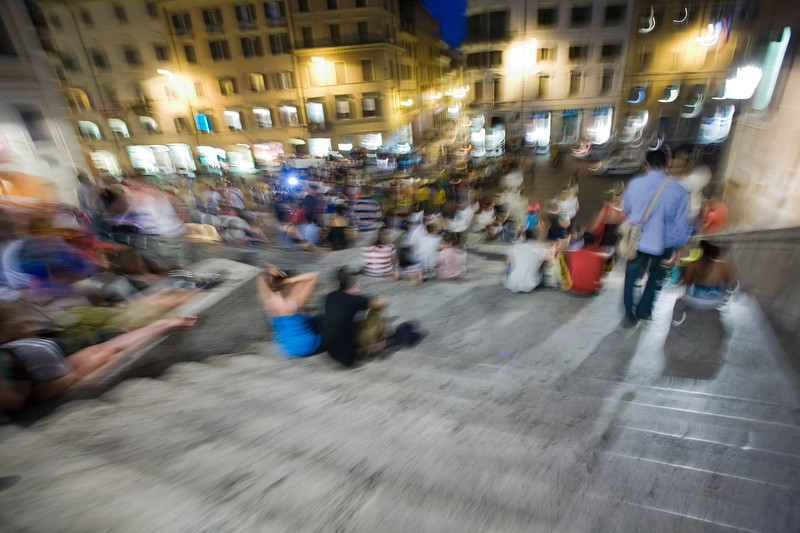 Blurry image of young people sitting at Spanish steps, Rome