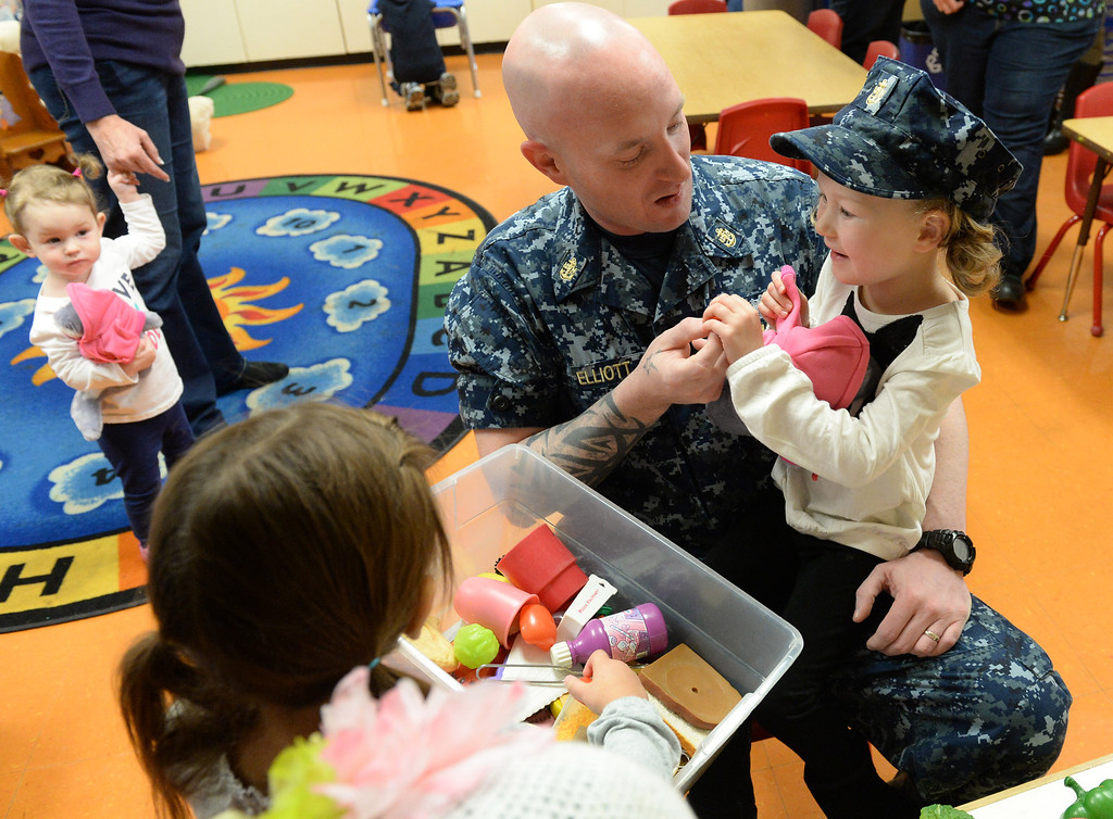 . Navy Chief Nick Elliot who\'s been deployed for five month, surprised his four-year-old daughter Alexis in her classroom at First Lutheran Children\'s Center in Redlands,CA. Thursday, Nov. 21, 2013. Elliot\'s was deployed overseas, serving in the Persian Golf on the USS Harry S. Truman, this was the longest he has ever been away from his family. (John Valenzuela/Staff Photographer)