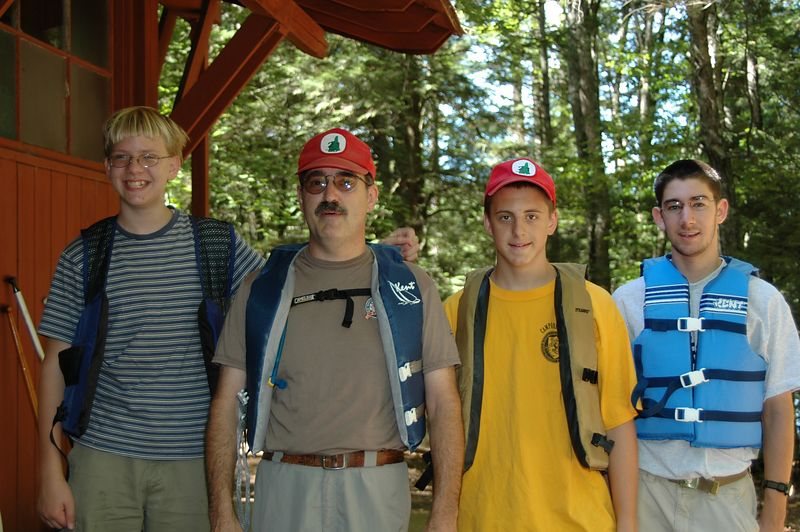 """Troup 21 B   (Sep 11, 2004, 11:30am)  Boy Scout Troup 21, from Hudson, NH, split up into two groups of four people each.  This group, self named """"B"""", used two canoes.  The other group, self named """"Dibble"""" and shown in the next picture, used four single person kayaks.  The two groups started at a few minutes apart and split up once they reached the lake."""