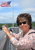 2015-06-06 Hudson River Bridge River Walk V(18) Kathy and Flag