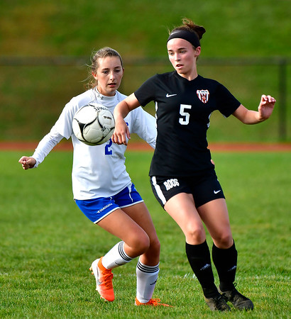10/10/2019 Mike Orazzi | StaffrTerryville High School's Kylie Fernet (5) and Nonnewaug's Alexa Burke (2) at THS on Thursday.