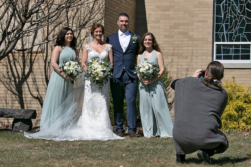 At a very small ceremony at Our Lady of the Lake Church on Saturday, March 21, 2020 in Leominster Virginia Pacifico from Leominster and James Pacifico from Cairo New York got married. They posed for pictures outside of the church after the ceremony. They where supposed to have had the ceremony in Nashville Tennessee but due to the coronavirus they were not able to. They picked Our Lady of the Lake because Virginia's family goes to that church. They had been seeing each other for the past 6 years. They now live in Watetown MA. Photographer Kelly DeGroot takes pictures of the couple with James sisters Cait McCloskey and Lauren Pacifico. SENTINEL & ENTERPRISE/JOHN LIOVE