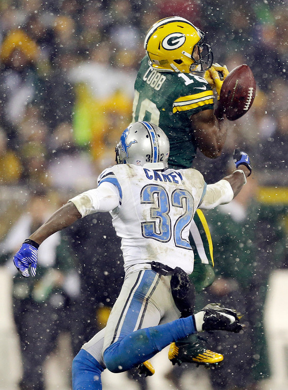 . Green Bay Packers\' Randall Cobb (18) can\'t handle a pass while being defended by Detroit Lions\' Don Carey (32) during the second half of an NFL football game Sunday, Dec. 9, 2012, in Green Bay, Wis. (AP Photo/Jeffrey Phelps)