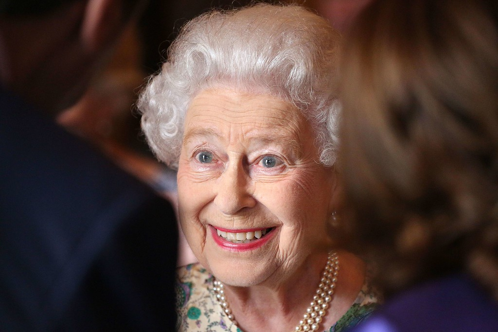 . Britain\'s Queen Elizabeth II is pictured at a reception for the Winners of the Queens Award for Enterprise 2013 at Buckingham Palace in London, on July 23, 2013. Britain\'s Prince William and his wife Kate proudly showed off their newborn baby son to the world for the first time on Tuesday, cradling the future king in their arms as they left hospital to go home. PHILIP TOSCANO/AFP/Getty Images