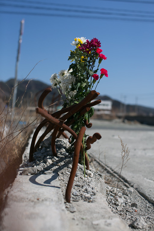 . A bouquet of flowers stands in rubble on March 11, 2013 in Ootsuti, Iwate prefecture, Japan.  On March 11 Japan commemorates the second anniversary of the magnitude 9.0 earthquake and tsunami that claimed more than 18,000 lives.  (Photo by Ken Ishii/Getty Images)