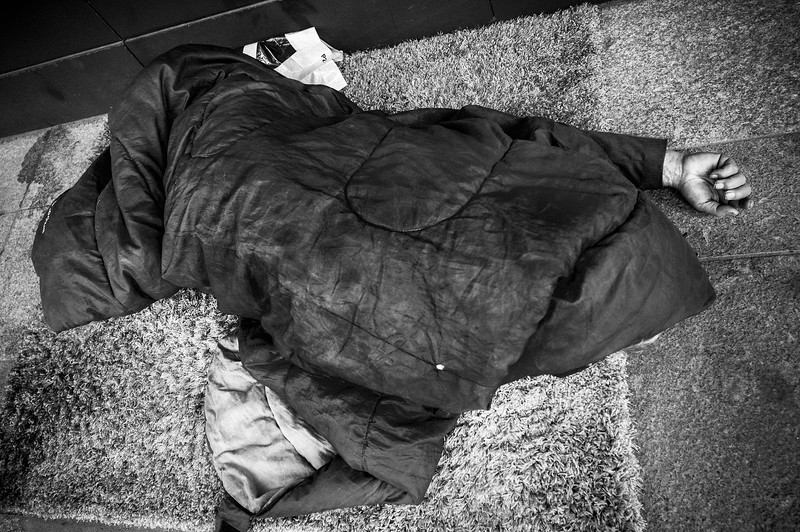 HOMELESS_GUY_SLEEPING_ON_GROUND_HAND_STICKING_OUT_PARIS.jpg