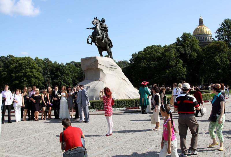 Russian wedding photos (and onlookers!) at the Bronze Horseman, St Petersburg.
