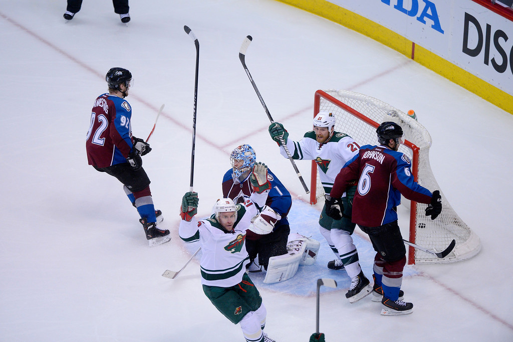 . Wild players celebrate a goal by Nino Niederreiter (22) of the Minnesota Wild during the third period of action.  (Photo by Karl Gehring/The Denver Post)