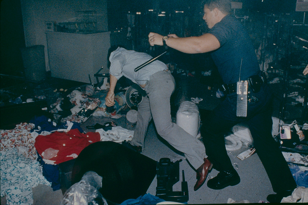 . An LAPD Officer forces a looter to give up his treasure while pushing him out of a Sears Store in Hollywood. April 30, 1992. (Photo by John McCoy/Los Angeles Daily News)