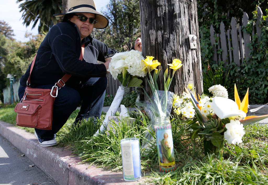 """. A woman who did not want to be named drops flowers off at a makeshift memorial on Branciforte Ave. and Doyle St. for slain Santa Cruz police officers, detective Sgt. Loran \""""Butch\"""" Baker and detective Elizabeth Butler in Santa Cruz, Calif. on Wednesday, Feb. 27, 2013. The pair were gunned down near  this location yesterday while investigating a possible domestic violence or sexual assault when a suspect fired at them. The gunman, Jeremy Peter Goulet, was later gunned down when he exchanged gunfire with police during a manhunt. (Gary Reyes/ Staff)"""